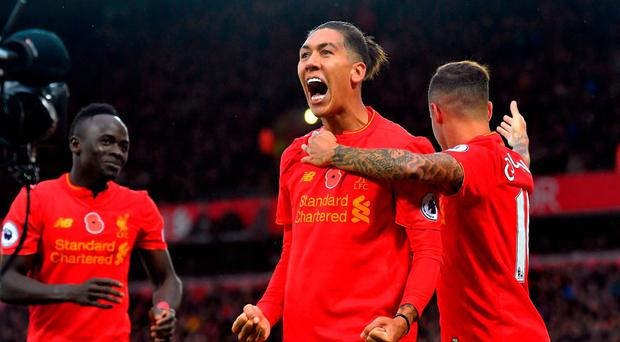 Liverpool's Roberto Firmino celebrates scoring with Philippe Coutinho