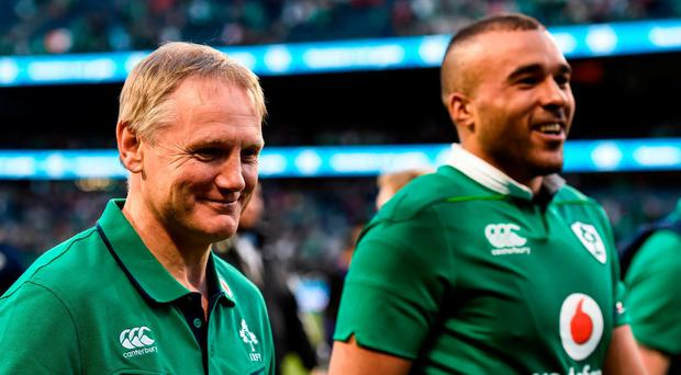 Ireland head coach Joe Schmidt and Simon Zebo of Ireland celebrate victory after the International rugby match between Ireland and New Zealand at Soldier Field in Chicago