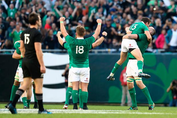 Ireland players celebrate at the final whistle after their victory over New Zealand. Photo by Phil Walter/Getty Images