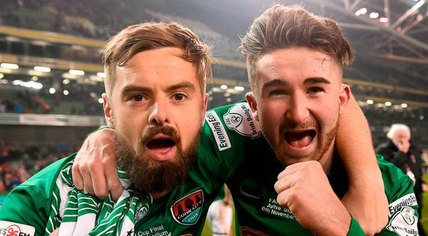 Cork City players Greg Bolger (L) and Sean Maguire (right) celebrate at the end of the Cup Final. Photo by David Maher/Sportsfile