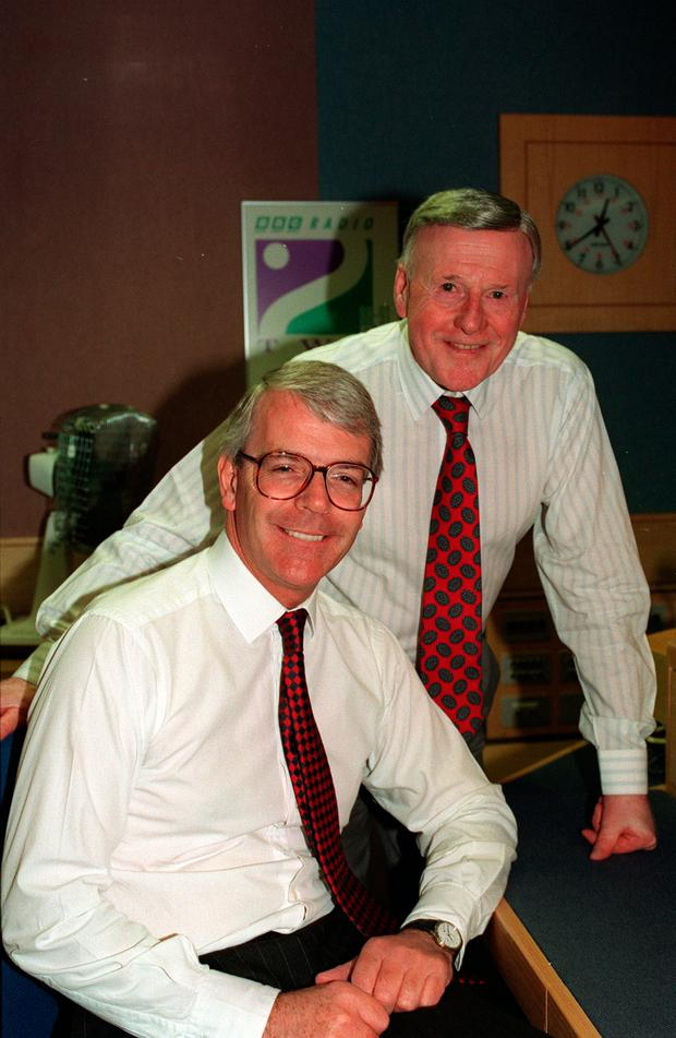 File photo dated 19/05/1993 of Jimmy Young (behind) with the then Prime Minister John Major as the the veteran broadcaster has died
