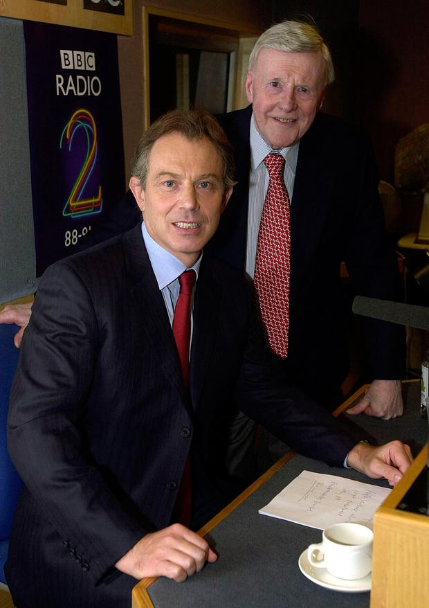 File photo dated 24/01/2002 of Britain's Prime Minister Tony Blair after giving an interview on BBC Radio 2's Jimmy Young (behind) programme as the veteran broadcaster has died