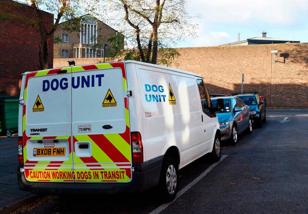 A police dog unit van outside Pentonville Prison, north London, where two inmates escaped from, it has emerged. Charlotte Ball/PA Wire