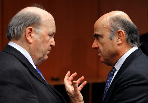 Finance Minister Michael Noonan and Spain's Economy Minister Luis de Guindos attend a eurozone finance ministers meeting in Brussels. Photo: Yves Herman