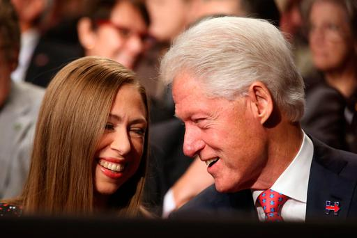 Former US President Bill Clinton (R) talks with his daughter Chelsea Clinton prior to the third and final 2016 presidential campaign debate. Photo: Reuters