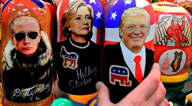 Traditional Russian wooden nesting dolls, Matryoshka dolls, depicting Russia's President Vladimir Putin, US Democratic presidential nominee Hillary Clinton and US Republican presidential nominee Donald Trump are seen on sale at a gift shop in central Moscow on November 8, 2016. / AFP PHOTO / Kirill KUDRYAVTSEVKIRILL KUDRYAVTSEV/AFP/Getty Images
