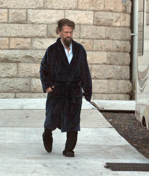 Actor Sean Penn sporting wild hair and a ragged beard on the set of his new movie