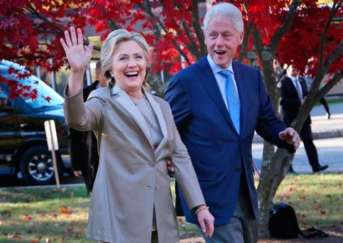 Democratic presidential candidate Hillary Clinton, and her husband former President Bill Clinton, greet supporters after voting in Chappaqua, N.Y., Tuesday, Nov. 8, 2016. (AP Photo/Seth Wenig)