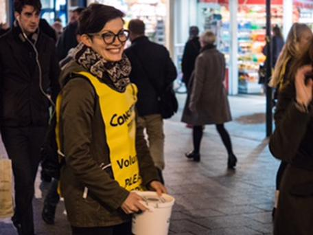 Member of Concern collecting donations