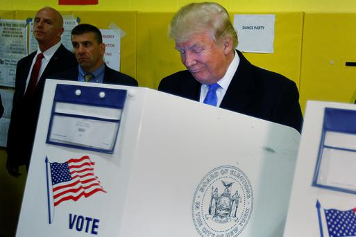 Republican presidential nominee Donald Trump votes at PS 59 in New York, New York, U.S. November 8, 2016. REUTERS/Carlo Allegri