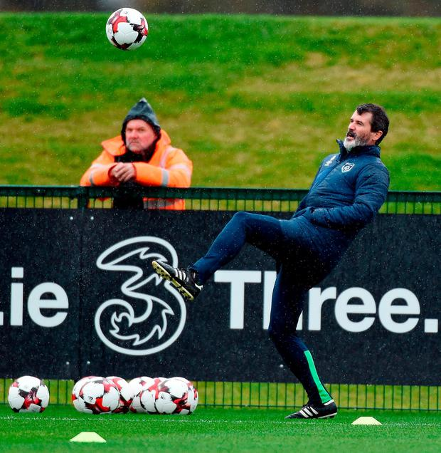 Ireland assistant manager Roy Keane shows he hasn't lost his touch during yesterday's training session at Abbotstown. Photo: DAVID MAHER/SPORTSFILE