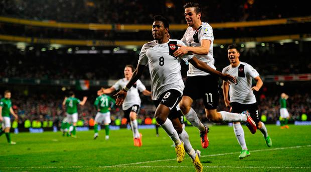 Austria's David Alaba celebrates after securing a draw that felt like a defeat for Ireland in 2013. (Photo by Stu Forster/Getty Images)