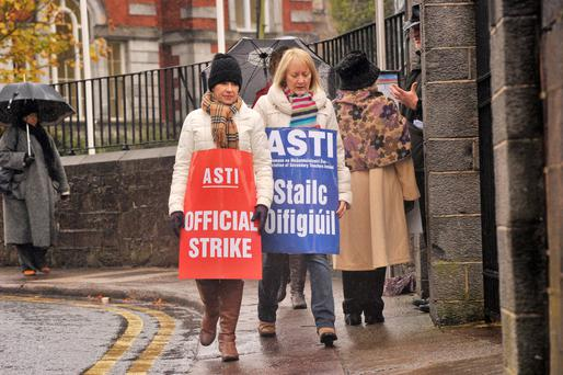 Helen Lynch and Anne Roche Cagney on the picket line at St Aloysius Secondary School, Cork city. Photo: Daragh McSweeney/Provision