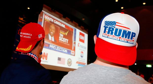 Supporters of Republican presidential candidate Donald Trump watch the results of the U.S. elections at the United States Studies Centre at the University of Sydney on November 9, 2016 in Sydney, Australia (Photo by Daniel Munoz/Getty Images)