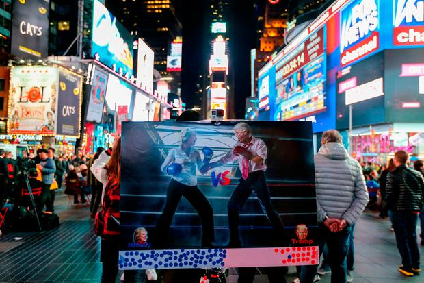 A graphic depicting Hillary Clinton and Donald Trump squaring off in a boxing ring sits in Times Square on November 8, 2016 in New York City. (Photo by Michael Reaves/Getty Images)