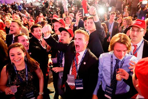People cheer as voting results for Florida come in at Republican presidential nominee Donald Trumps election night event at the New York Hilton Midtown on November 8, 2016 in New York City. (Photo by Chip Somodevilla/Getty Images)
