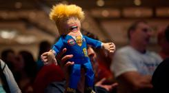 A supporter of Republican presidential candidate Donald Trump holds up a Trump doll during an election night party at a hotel in downtown Phoenix, Arizona on November 8, 2016. / AFP PHOTO / Laura SegallLAURA SEGALL/AFP/Getty Images