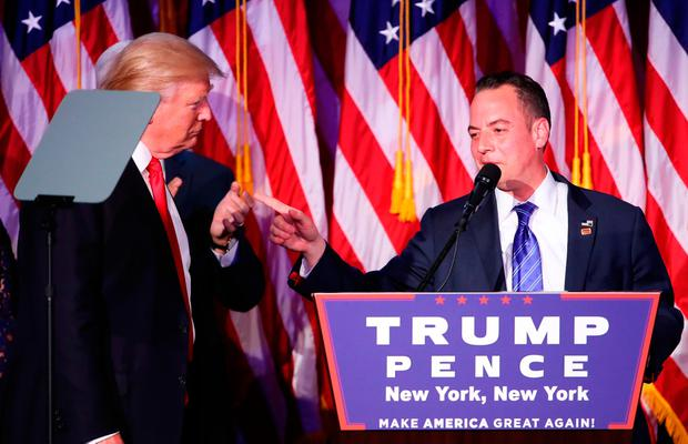 Reince Priebus, chairman of the Republican National Committee, delivers a speech as Republican president-elect Donald Trump looks on during his election night event at the New York Hilton Midtown in the early morning hours of November 9, 2016 in New York City. Donald Trump defeated Democratic presidential nominee Hillary Clinton to become the 45th president of the United States. (Photo by Mark Wilson/Getty Images)