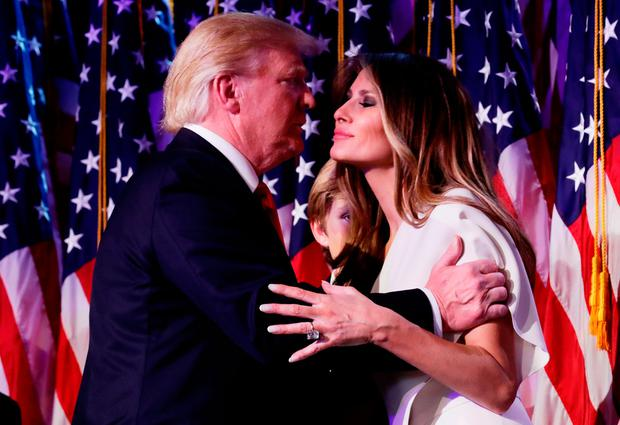 Republican president-elect Donald Trump embraces his wife Melania Trump during his election night event at the New York Hilton Midtown in the early morning hours of November 9, 2016 in New York City. (Photo by Chip Somodevilla/Getty Images)