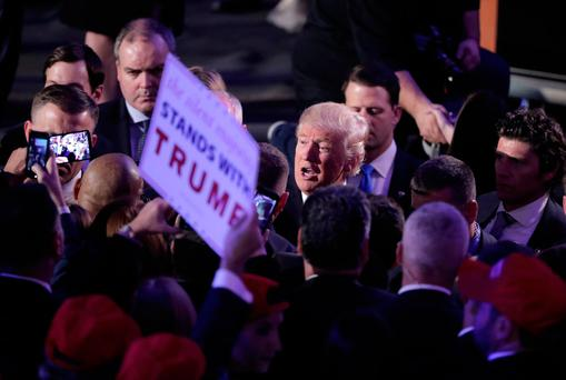 President-elect Donald Trump talks to his supporters after giving his acceptance speech during his election night rally, Wednesday, Nov. 9, 2016, in New York. (AP Photo/Julie Jacobson)