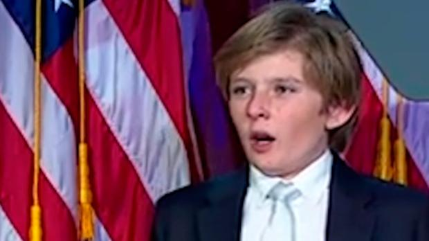 Barron Trump struggles to stay awake during his father's victory speech