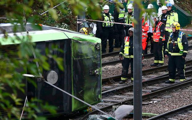 Members of the emergency services work next to a tram after it overturned injuring and trapping some passengers in Croydon, south London, Britain November 9, 2016. REUTERS/Neil Hall