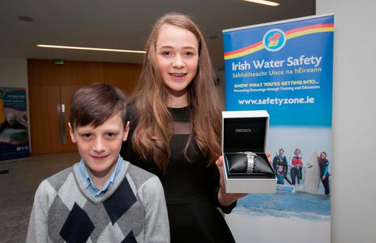 Emily Duggan (13) with her brother Justin (10) who was saved after an incident with a disused septic tank.