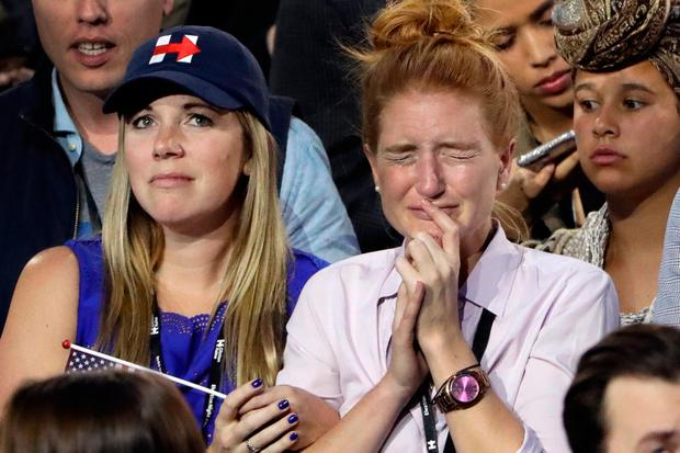 Supporters watch the election results during Democratic presidential nominee Hillary Clinton's election night rally in the Jacob Javits Center glass enclosed lobby in New York, Tuesday, Nov. 8, 2016. (AP Photo/Matt Rourke)