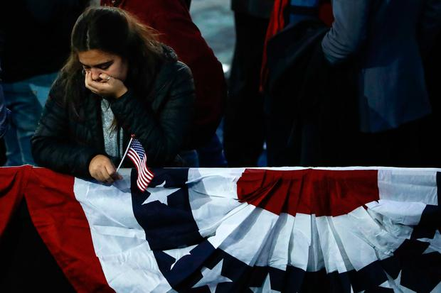 A supporter reacts after hearing that Democratic presidential nominee Hillary Clinton wouldn't be coming to the Jacob Javits Center in New York, Wednesday, Nov. 9, 2016 as votes are continuing to be counted. (AP Photo/Matt Rourke)
