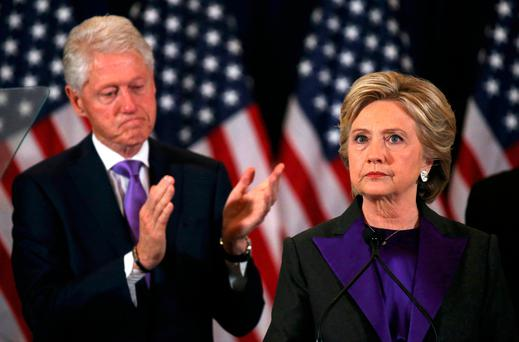 Hillary Clinton addresses her staff and supporters about the results of the U.S. election as her husband, former U.S. President Bill Clinton, applauds at a hotel in the Manhattan borough of New York, U.S., November 9, 2016. REUTERS/Carlos Barria