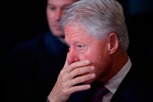 Former President Bill Clinton listens as his wife, Democratic presidential candidate Hillary Clinton speaks in New York, Wednesday, Nov. 9, 2016. (AP Photo/Andrew Harnik)
