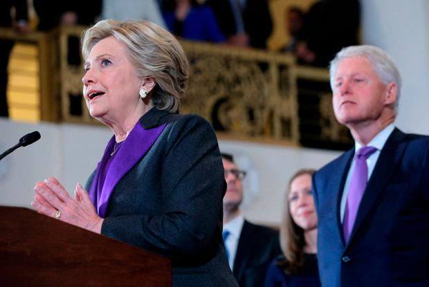 Hillary Clinton addresses her staff and supporters about the results of the U.S. election as her husband, former U.S. President Bill Clinton (R), their daughter Chelsea and her son in law Marc Mezvinsky look on, at a hotel in the Manhattan borough of New York, U.S., November 9, 2016. REUTERS/Brian Snyder