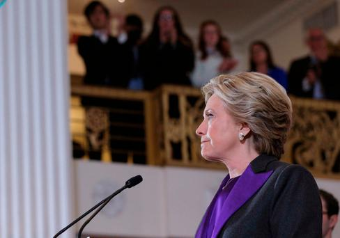 Hillary Clinton pauses as she addresses her staff and supporters about the results of the U.S. election at a hotel in the Manhattan borough of New York, U.S., November 9, 2016. REUTERS/Brian Snyder