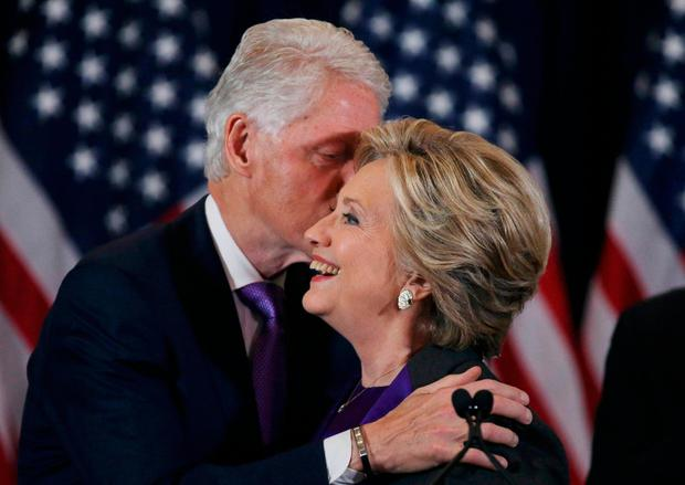 Hillary Clinton is embraced by her husband former U.S. President Bill Clinton (L), as she addresses her staff and supporters about the results of the U.S. election at a hotel in New York, November 9, 2016. REUTERS/Carlos Barria