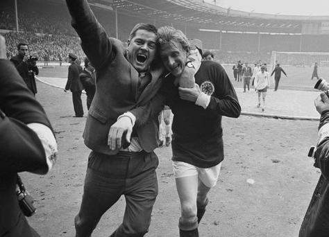 Denis Law is hugged by a fan after Scotland beat England 3-2 at Wembley in 1967. Photo: Larry Ellis/Express/Hulton Archive/Getty Images