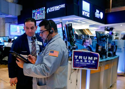 Traders work on the floor of the New York Stock Exchange (NYSE) the morning after the US presidential election in New York City. Photo: Reuters