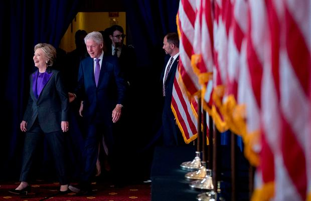 Hillary Clinton, with husband Bill, arrives to speak to supporters. (AP Photo/Andrew Harnik)