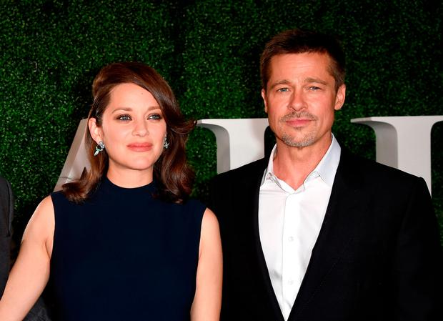 Actress Marion Cotillard (L) and actor Brad Pitt attend the fan event for Paramount Pictures'