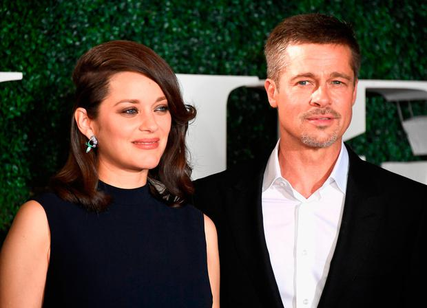 Actress Marion Cotillard and actor Brad Pitt attend the fan event for Paramount Pictures' 'Allied' at Regency Village Theatre on November 9, 2016 in Westwood, California. (Photo by Frazer Harrison/Getty Images)