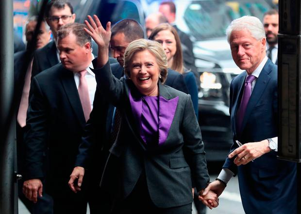 Hillary and Bill Clinton arrive to the New Yorker Hotel where she was to address supporters on November 9, 2016 in New York City. The former Democratic Presidential nominee conceded defeat to president-elect Donald Trump earlier in the morning. (Photo by John Moore/Getty Images)
