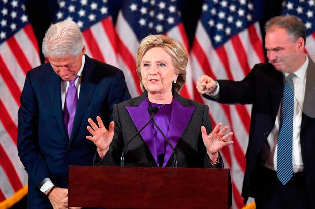 US Democratic presidential candidate Hillary Clinton makes a concession speech after being defeated by Republican President-elect Donald Trump, as former President Bill Clinton and running mate Tim Kaine(R) look on in New York
