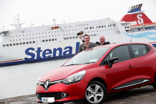 Ryan Tubridy and Stena Line's Senior Master Colm Clare with the brand new Renault Clio