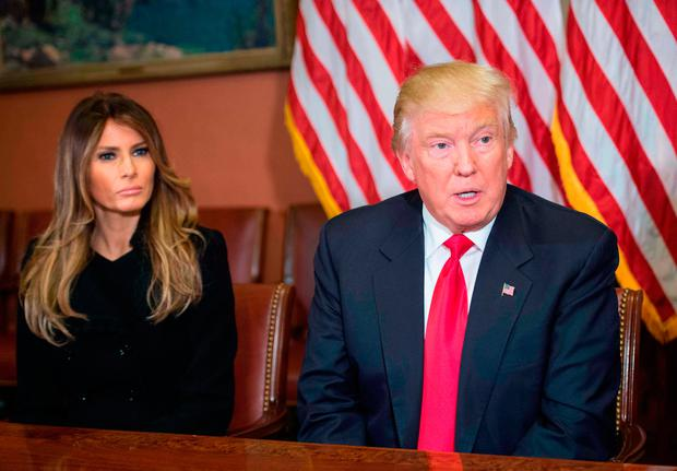 Melania Trump listens to her husband US President-elect Donald Trump speak to the press at the US Capitol in Washington, DC, on November 10, 2016. / AFP PHOTO / NICHOLAS KAMMNICHOLAS KAMM/AFP/Getty Images