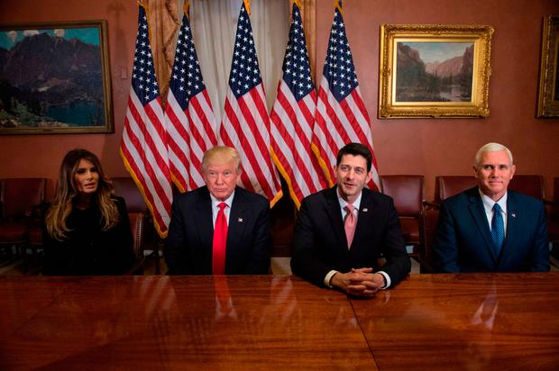 (From L to R) Melania Trump, US President-elect Donald Trump, House Speaker Paul Ryan and Vice President-elect Mike Pence meet at the US Capitol in Washington, DC, on November 10, 2016. / AFP PHOTO / NICHOLAS KAMMNICHOLAS KAMM/AFP/Getty Images