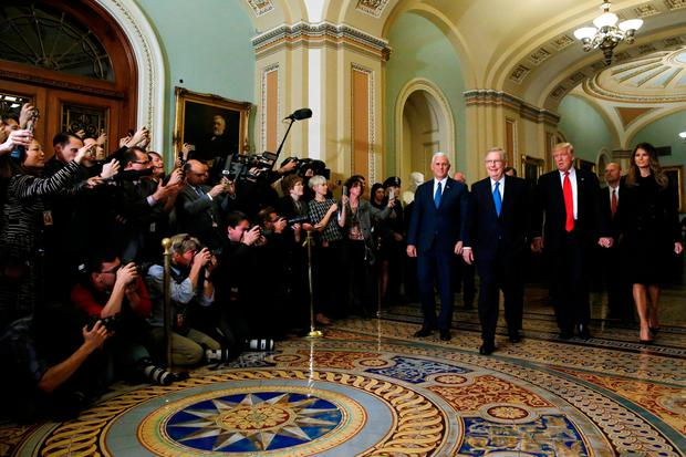 U.S. President-elect Trump (2nd R), his wife Melania Trump (R), Vice President-elect Mike Pence (4th R) and Senate Majority Leader Mitch McConnell (R-KY) (3rd R) walk together to meet in McConnell's office at the U.S. Capitol in Washington, U.S. November 10, 2016. REUTERS/Jonathan Ernst