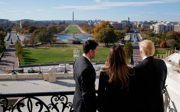 U.S. Speaker of the House Paul Ryan (R-WI) (L) shows Melania Trump and U.S. President-elect Donald Trump the Mall from the Speaker's Balcony on Capitol Hill in Washington, U.S., November 10, 2016. REUTERS/Joshua Roberts