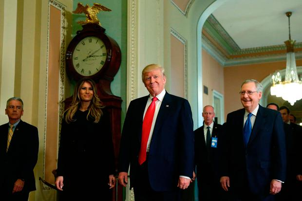 US President-elect Donald Trump (C) talks to the media with his wife Melania Trump after a meeting with Senate Majority Leader Mitch McConnell(R) R-KY on Capitol Hill in Washington, DC on November 10, 2016. / AFP PHOTO / YURI GRIPASYURI GRIPAS/AFP/Getty Images