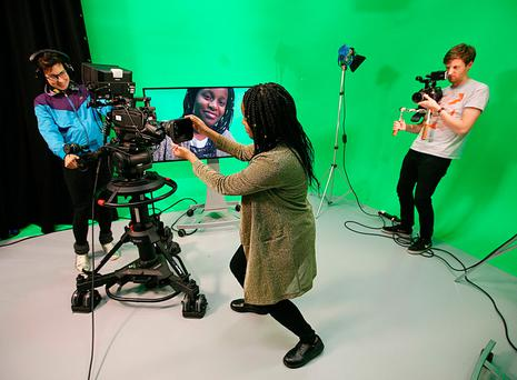 Scriptwriter and producer Stephanie Preissner (of 'Can't Cope Won't Cope fame') films student Benita Muranda, from Stillorgan, during her visit to the National Film School at the Institute of Art and Design Technology in Dun Laoghaire, which this week is running a masterclass for young women. Photo: Brian Farrell