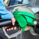 The price of filling up your car has fallen slightly. Stock Photo