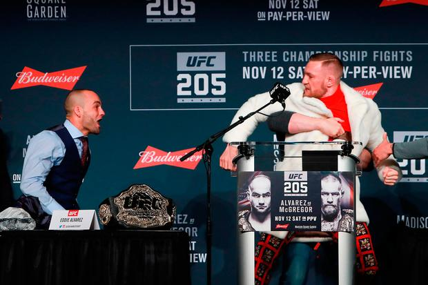 UFC president Dana White separates Conor McGregor and Eddie Alvarez during the UFC 205 press conference at The Theater at Madison Square Garden